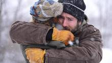 Matthew (Ryan Reynolds) clings to his daughter, Cass Lane (Alexia Fast), in Atom Egoyan's The Captive.