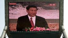 A huge screen shows a live broadcast of China's new Communist Party General Secretary Xi Jinping speaking during a press event to introduce the newly-elected members of the Politburo Standing Committee, in Beijing Thursday, Nov. 15, 2012. The seven-member Standing Committee, the inner circle of Chinese political power, was paraded in front of assembled media on the first day following the end of the 18th Communist Party Congress. (Andy Wong/AP Photo)