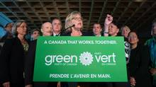 Green Party Leader Elizabeth May, centre, is flanked by local candidates while speaking during a campaign event in Vancouver, B.C., on Wednesday September 9, 2015. A federal election will be held October 19. (DARRYL DYCK/THE CANADIAN PRESS)