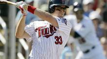 Minnesota Twins' Justin Morneau bats during the fifth inning of a spring training baseball game against the Tampa Bay Rays, Saturday, March 3, 2012, in Fort Myers, Fla. (David Goldman/AP)