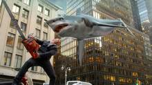 Ian Ziering, as Fin Shepard, battles a shark with a giant chainsaw on a New York City street in Sharknado 2: The Second One. (Syfy/THE ASSOCIATED PRESS)