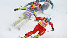 Switzerland's Katrin Mueller, front, Canada's Marielle Thompson, left, in action during the women's skicross final at the World Cup ski event in Bischofswiesen, southern Germany , Feb. 26, 2012. (Kerstin Joensson/The Associated Press/Kerstin Joensson/The Associated Press)