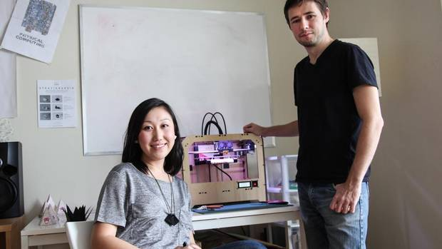 Architects Bi-Ying Miao and Matt Compeau run their startup from the living room of their one-bedroom apartment in Toronto (Rosa Park)