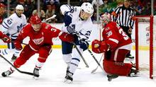 James van Riemsdyk of the Toronto Maple Leafs controls the puck between Jimmy Howard and Nick Jensen of the Detroit Red Wings at Joe Louis Arena on April 1, 2017 in Detroit, Michigan. (Gregory Shamus/Getty Images)