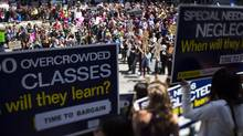 Striking B.C. teachers at the Vancouver Art Gallery during a noon time rally June 16, 2014. Offer to give educators a bonus to sign a deal ends, with some calling it 'insulting.' (John Lehmann/The Globe and Mail)