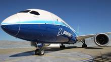 A 787 Dreamliner sits on the tarmac at Boeing Commercial Airplanes manufacturing facilities at Paine Field, Everett, Washington during the jetliner's certification event on August 26, 2011. (Anthony Bolante/Reuters)