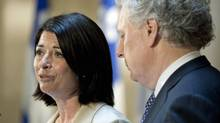 With Premier Jean Charest looking on, Line Beauchamp announces her resignation as education minister and deputy premier at a Quebec City news conference on May 14, 2012. (Jacques Boissinot/Jacques Boissinot/The Canadian Press)