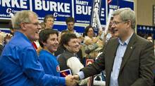 Prime Minister Stephen Harper shakes hands with supporters while campaigning for local candidate Marty Burke in Guelph, Ont., on April 4, 2011. (Sean Kilpatrick/Sean Kilpatrick/The Canadian Press)