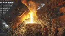 Labourers work at a steel factory in Dalian, Liaoning province July 13, 2012. (CHINA DAILY/REUTERS)