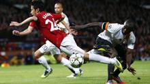 Manchester United's Shinji Kagawa (L) is challenged by Galatasaray's Selcuk Inan during their Champions League Group H soccer match at Old Trafford in Manchester, northern England, September 19, 2012. (DARREN STAPLES/REUTERS)