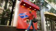 A pedestrian walks past a Bank of America ATM in Charlotte, North Carolina, in this file photo. (CHRIS KEANE/REUTERS)