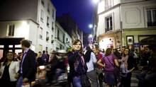 Pedestrians outside Prohibido, a bar at Rue Durantin and Rue Tholoze in Paris. (KATIE ORLINSKY/NYT)