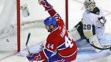 Montreal Canadiens Roman Hamrlik celebrates his team's goal on Pittsburgh Penguins goalie Marc-Andre Fleury during the third period in Game 4 of their NHL Eastern Conference semi-final hockey series in Montreal, May 6, 2010. (SHAUN BEST/REUTERS)