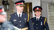 Belleville's Chief of Police Cory McMullan, right, leaves John R. Bush funeral home after attending the funeral for Jessica Lloyd on Feb. 12, 2010. (Bryanna Bradley for The Globe and Mail)