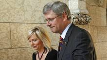 Conservative MP Candace Hoeppner and Prime Minister Stephen oustide the House of Commons on Wed., Sept. 22, after Ms. Hoeppner's private-member's bill to abolish the gun registry was defeated. (CHRIS WATTIE/Chris Wattie/Reuters)