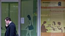 A pedestrian passes by the Republic Plaza Building, which is owned and managed by Brookfield Asset Management Inc.. (Bloomberg/ Matthew Staver/Bloomberg/ Matthew Staver)