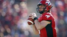 Calgary Stampeders' quarterback Drew Tate looks for a receiver during first half CFL football action against the Montreal Alouettes in Calgary, Alta., Sunday, July 1, 2012. (Jeff McIntosh/THE CANADIAN PRESS)