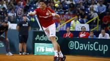 Canada's Milos Raonic returns the ball to Serbia's Janko Tipsarevic during their Davis Cup semi-final tennis match in Belgrade September 13, 2013. (MARKO DJURICA/REUTERS)