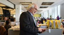 While checking his iPad, John Cruickshank, publisher of the Toronto Star, is pictured in the newspaper's newsroom on Sept 14 2015. The Star will be launching their new tablet app on Sept 15 2015. (Fred Lum/The Globe and Mail)