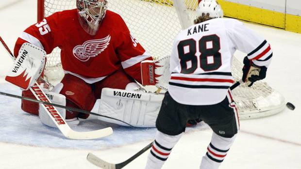 Detroit Red Wings goalie Jimmy Howard (35) makes a save on Chicago Blackhawks right wing Patrick Kane (88) in the first period. (REBECCA COOK/REUTERS)