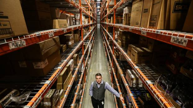 Barry Reid, Flanagan's vice-president for sales and marketing, stands in the company's warehouse distribution centre in Kitchener, Ont. The company has an inventory of about 10,000 warehoused products.