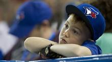 A young fan during the ninth inning of the Toronto Blue Jays losing home opener against the Cleveland Indians at Rogers Centre in Toronto on April 2, 2013. (Peter Power/The Globe and Mail)