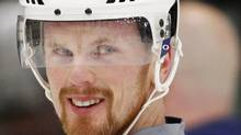 Vancouver Canucks' Daniel Sedin unbuckles his helmet strap as he leaves the ice after a practice for Game 4 of the team's NHL Western Conference quarter-final hockey playoff against the Los Angeles Kings at the Kings' practice facility in El Segundo, California April 17, 2012. REUTERS/Danny Moloshok (DANNY MOLOSHOK)