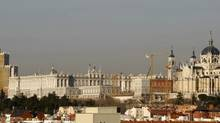 Part of the Madrid skyline is seen showing the Royal Palace, centre left, and the Almudena cathedral, right, in Madrid, Tuesday, March 10, 2009. A late surge by the unlikely candidate is heating up the competition to play host to the 2020 Summer Olympics. (Paul White/AP)
