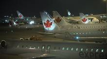 Currently, airlines are required to screen their flight manifests against the Secure Air Travel Act list, which is meant to prevent people with terrorist ties from getting on flights. (Fred Lum/The Globe and Mail)