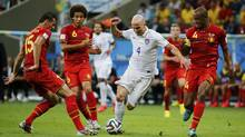 Michael Bradley of the U.S. controls the ball near Belgium's Axel Witsel (6), Daniel Van Buyten (15) and Vincent Kompany during their 2014 World Cup round of 16 game at the Fonte Nova arena in Salvador July 1, 2014. (SERGIO MORAES/REUTERS)