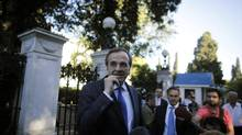 Greece's new Prime Minister Antonis Samaras speaks to reporters before a swearing- in ceremony of his new government outside the Presidential Palace in Athens on Thursday, June 21, 2012. (Kostas Tsironis/AP)