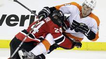 New Jersey Devils' Bryce Salvador, left, checks Philadelphia Flyers' James van Riemsdyk during the third period of Game 3 of a second-round NHL hockey Stanley Cup playoff series, Thursday, May 3, 2012 in Newark, N.J. (Associated Press)