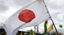 A Japanese flag flutters in the wind during an anti-nuclear demonstration in the western German town of Gronau close to the Dutch/German border in North-Rhine Westphalia March 11, 2012. (Wolfgang Rattay/Reuters/Wolfgang Rattay/Reuters)