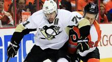 Pittsburgh Penguins' Evgeni Malkin, left, elbows Philadelphia Flyers' Erik Gustafsson in the face as they chase the puck during the first period in Game 6 of an NHL hockey Stanley Cup first-round playoff series, Sunday, April 22, 2012, in Philadelphia. (Tom Mihalek/AP)