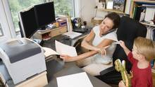 Working mother and son at home (Thinkstock Images/Getty Images/Comstock Images)