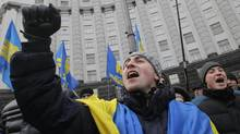 Opposition activists rally in front of the Cabinet of Ministers in Kiev on Dec. 4, 2013. (SERGEI CHUZAVKOV/ASSOCIATED PRESS)
