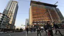 Pedestrians head for work among the highrise buildings at Spadina Avenue and Bremner Boulevard in Toronto. (Fred Lum/The Globe and Mail)