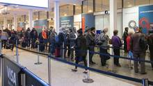 Montreal, PQ, Canada - November 15, 2015: Airline passengers waiting in line to pass through airport security at Pierre Eliott Trudeau airport (DoucetPh/iStockphoto)