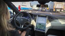 Self-driving cars like the Tesla Model S are arriving faster than anybody expected. (Jasper Juinen/Bloomberg)