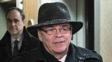 Former Quebec Federation of Labour president Michel Arsenault arrives at the Charbonneau Commission looking into corruption in the Quebec construction industry Monday, January 27, 2014 in Montreal. (Paul Chiasson/CP)