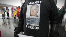 A protester outside the BC Liberal Convention in Vancouver Feb. 26, 2011. (John Lehmann/John Lehmann/The Globe and Mail)