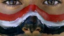 An anti-government protestor with the colours of his national flag painted on his face, during a demonstration demanding the resignation of Yemeni President Ali Abdullah Saleh, in Sanaa,Yemen, Thursday, March 24, 2011. (Muhammed Muheisen/AP Photo/Muhammed Muheisen)