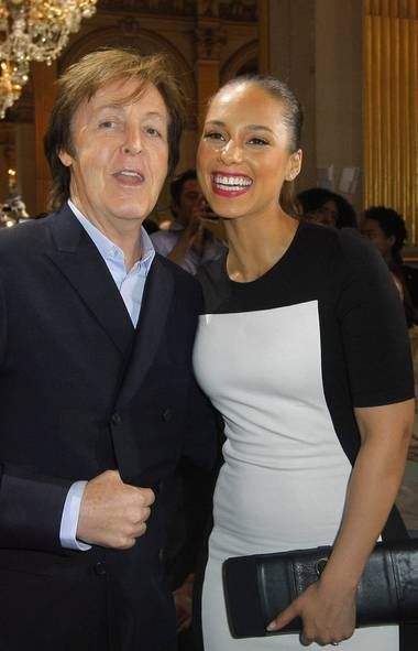 "Paul McCartney and Alicia Keys posed together for a photo before the Stella McCartney show on Monday morning. Sure, they were all smiles before hearing the runwayplay list, which included the electro-rap track I Fink U Freaky by Die Antwoord. ""Hey, you call thaaat music?!"" (JACQUES BRINON/JACQUES BRINON/AP)"