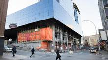 Pedestrians walk past the $500-million Nova Centre construction site on Argyle Street in downtown Halifax on Friday, March 4, 2016. Darren Calabrese for The Globe and Mail (Darren Calabrese For The Globe and Mail)