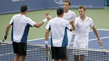 Mike Bryan and Bob Bryan shake hands with Vasek Pospisil and Jack Sock after defeating them in doubles championship match on day seven of the Western and Southern Open tennis tournament at Linder Family Tennis Center in Cincinnati on Aug. 17. (Mark Zerof/USA Today Sports)