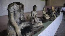 Damaged statues at a Buddhist temple that was torched in Ramu in the coastal district of Cox's Bazar, Bangladesh, Sunday, Sept. 30, 2012. (AP)