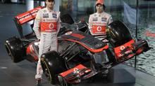 Vodafone McLaren Mercedes F1 drivers Jenson Button, left, and Sergio Perez, right (Lefteris Pitarakis/AP)