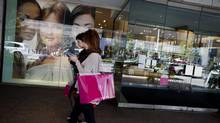 Shoppers outside the Holt Renfrew flagship store on Bloor Street in Toronto Jun 26, 2012. (Moe Doiron/The Globe and Mail)