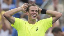 Vasek Pospisil from Canada celebrates after defeating Tomas Berdych from the Czech Republic in their match at the Rogers Cup tennis tournament in Montreal, Thursday, August 8, 2013. (GRAHAM HUGHES/THE CANADIAN PRESS)