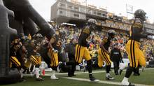 The Hamilton Tiger-Cats run onto the field to begin a game against the Winnipeg Blue Bombers at Ivor Wynne Stadium in Hamilton, ON, on Saturday, October 27, 2012. TT (Matthew Sherwood/The Globe and Mail)
